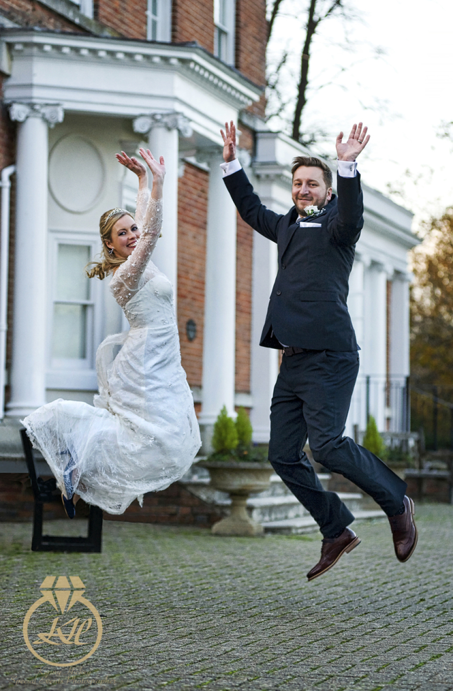 Clare & Darrol, winter wedding, East Court, fun, jumping