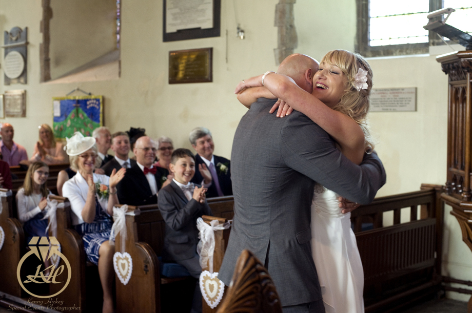 Bride & Groom hugging in church