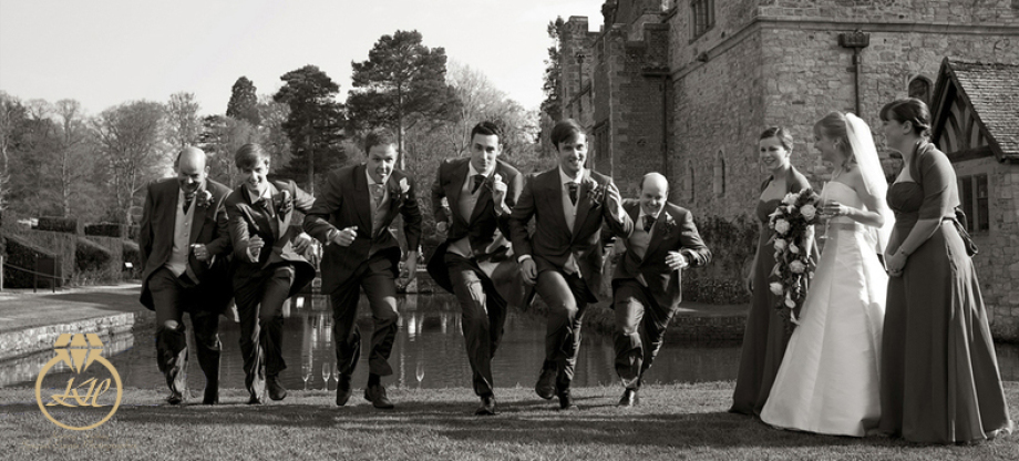 Groom & Groomsmen running at Hever Castle