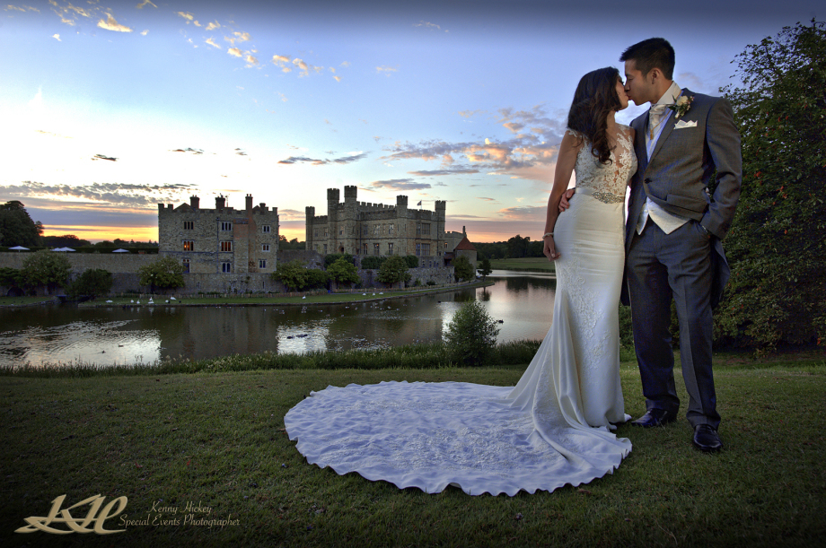 Chinese bride & groom kissing at sunset with Leeds Castle in the background