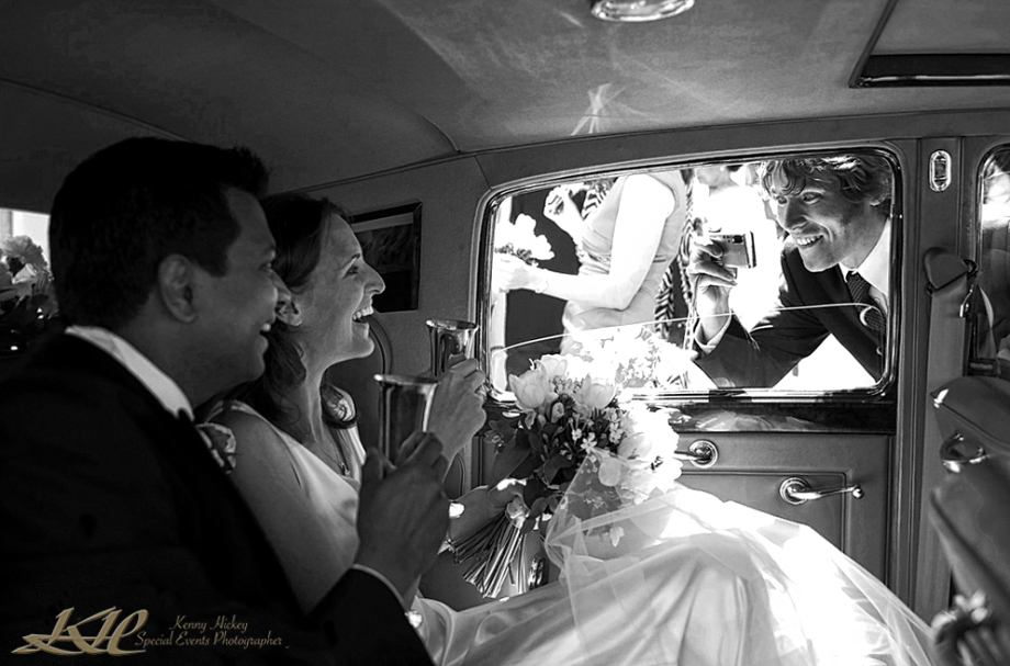 Bride & Groom being photographed in wedding car by guest, KennyHickey Photographer