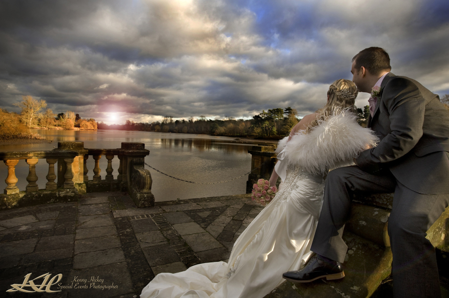 Bride & Groom looking down Hever Lake at the sunset