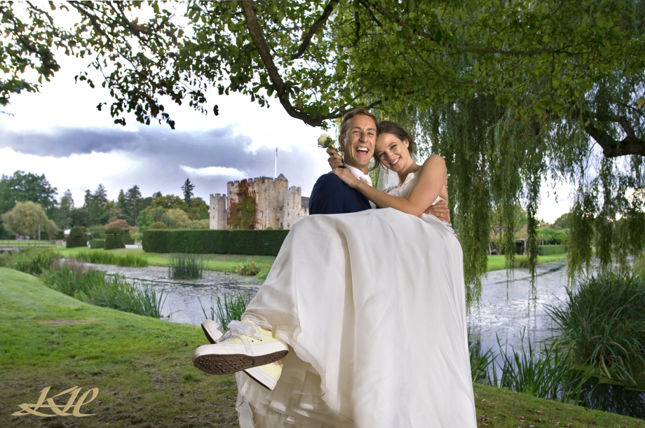 Groom carrying Bride outside Hever Castle