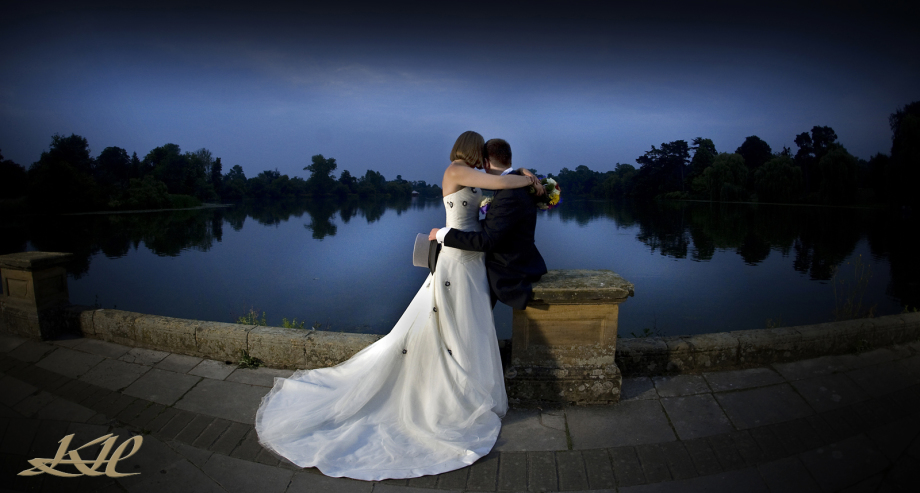 Bride & Groom hugging by Hever Castle Lake, Kenny Hickey Photography
