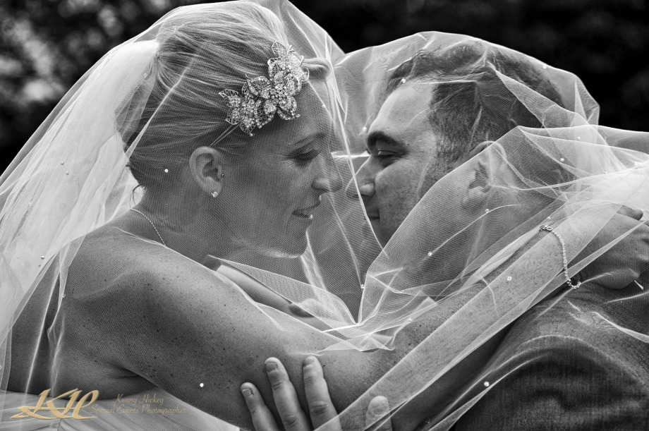 Bride & groom intimate under wedding veil in black & white, Kenny Hickey Photography, Kent Wedding Photographer