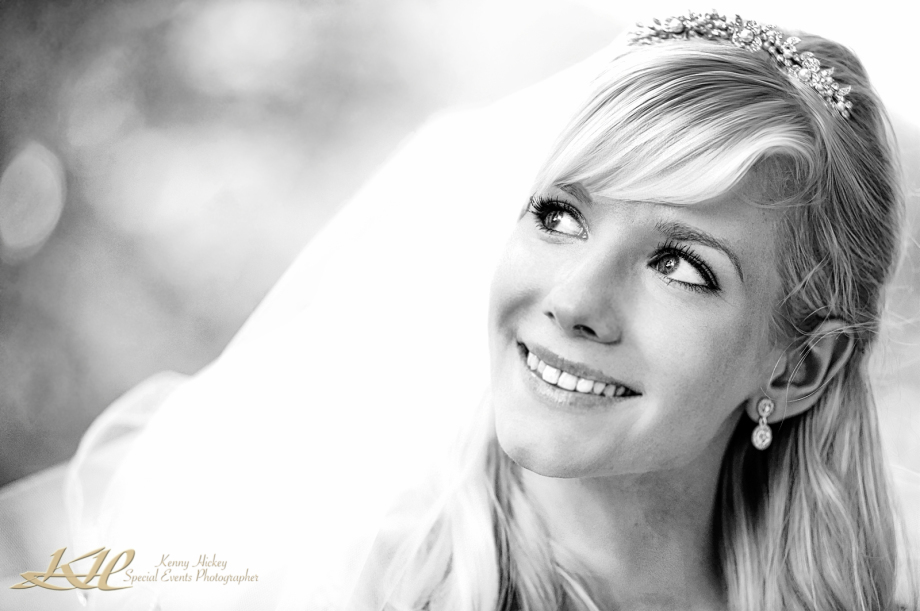 Beautiful young blond smiling bride in tiara and veil in black & white