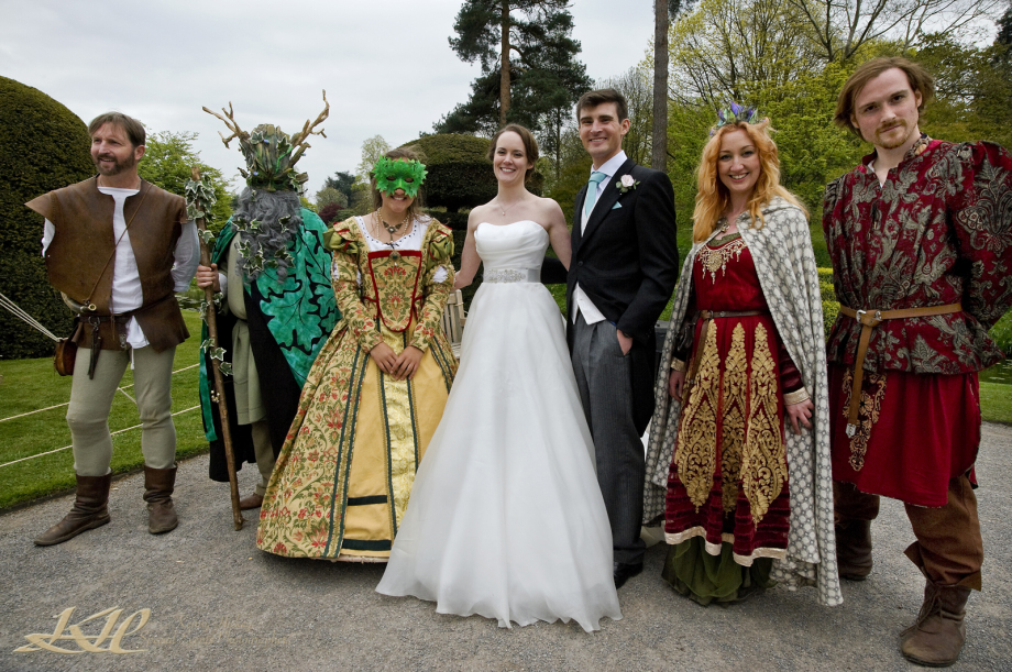 Bride & Groom with costume characters at `never Castle wedding