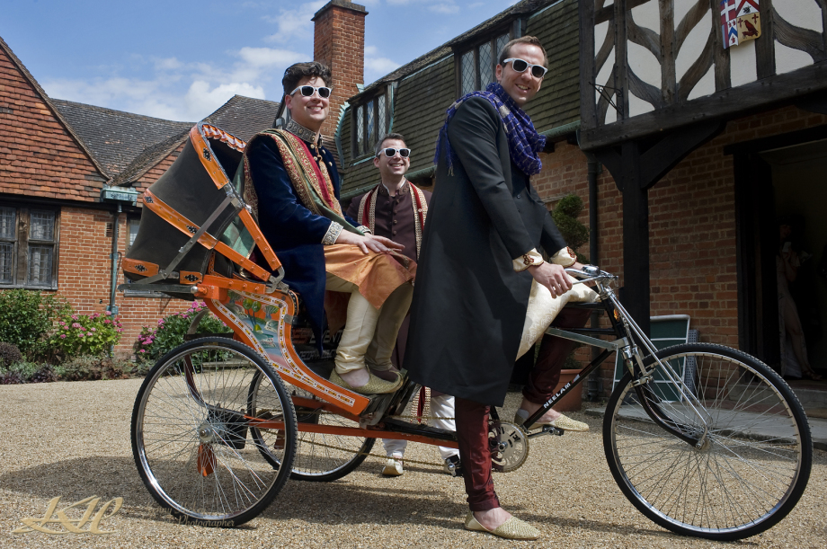 Groom and best man on indian tri-cycle outside Tudor `House, Hever Castle