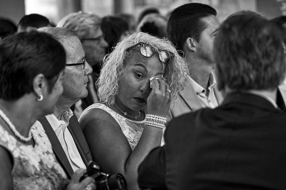 Wedding guest crying at wedding service Hever Castle