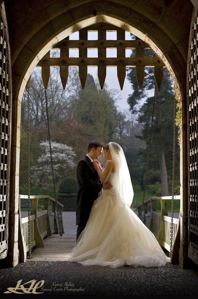 bride & groom on drawbridge at Hever Castle