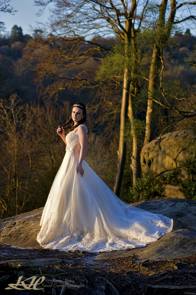 beautiful bride posing on High Rocks at sunset