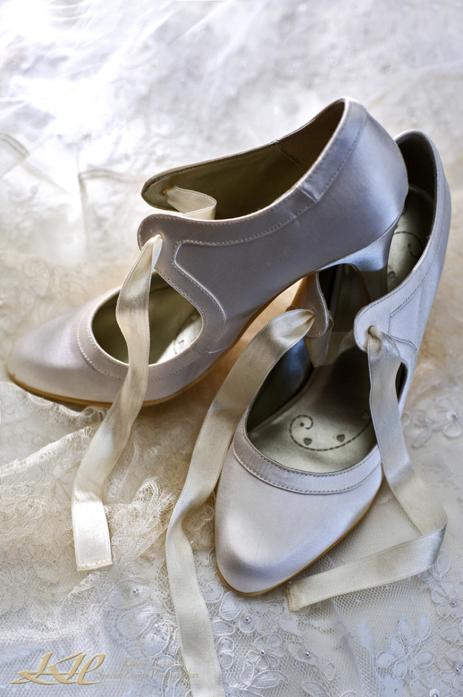 gorgeous wedding shoes on wedding dress