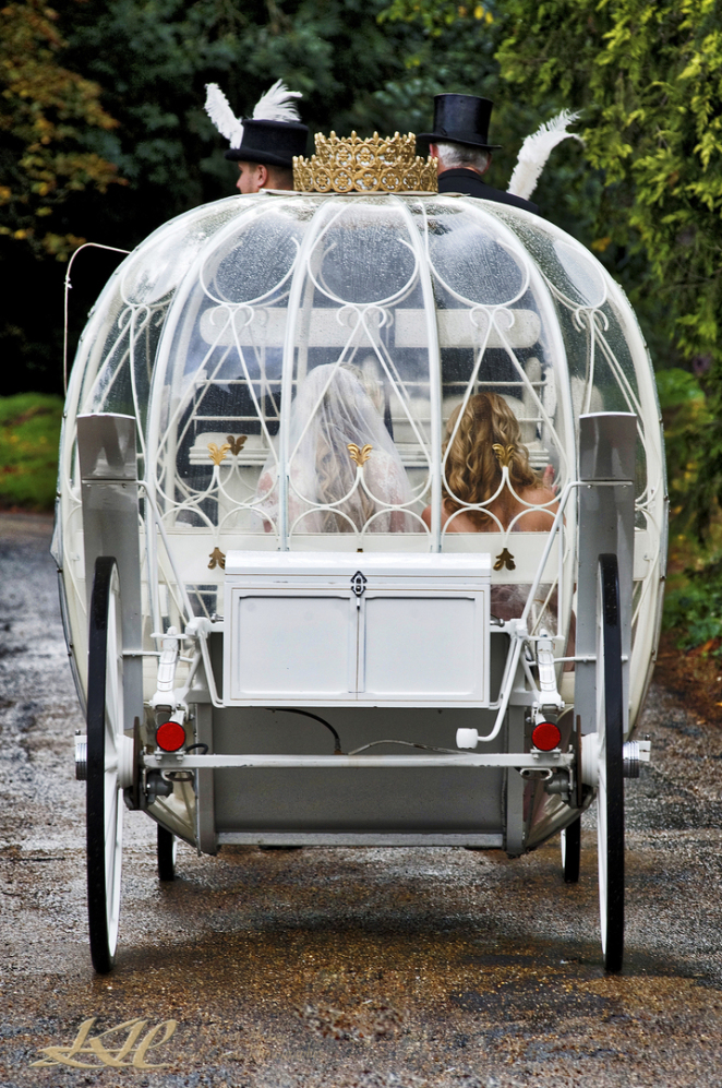 bride & bridesmaids in beautiful fairytale wedding carriage at Hever Castle