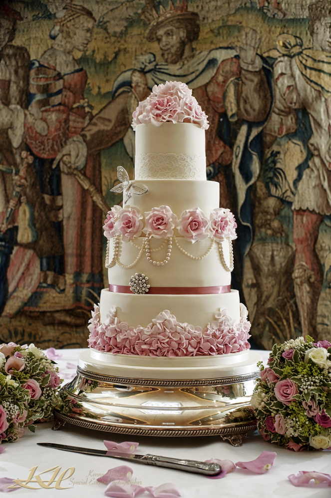 gorgeous wedding cake at Hever Castle in front of elizabethan tapestry