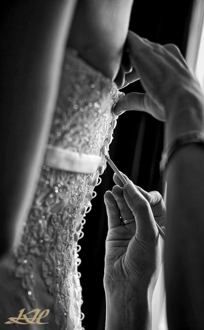 buttoning up wedding dress in black & white