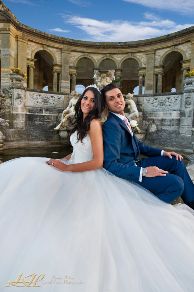 Italian bride and groom posing on the loggia at Hever Castle