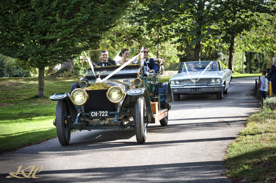 vintage wedding cars coming down hill at Hever Castle