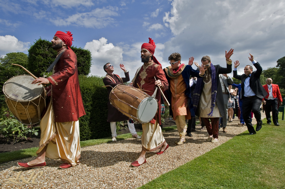 Indian wedding party playing drums at Hever Castle