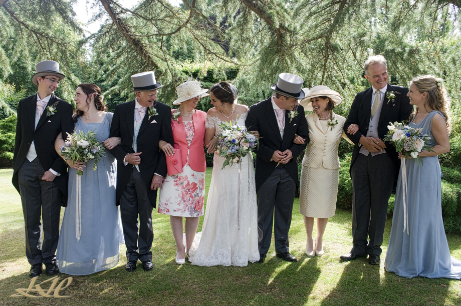 wedding party with groom and groomsmen in bowler hats bowler hats