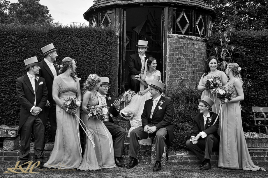 relaxed group of groomsmen and bridesmaids chatting