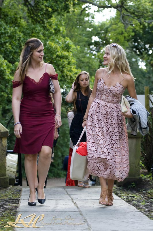 wedding guests walking to church in pink dresses