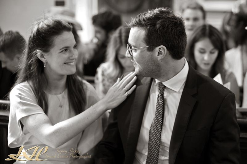 reportage wedding guests in church in black & white
