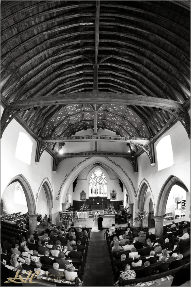 Lovely shot of ceremony at church taken from high balcony in black & white