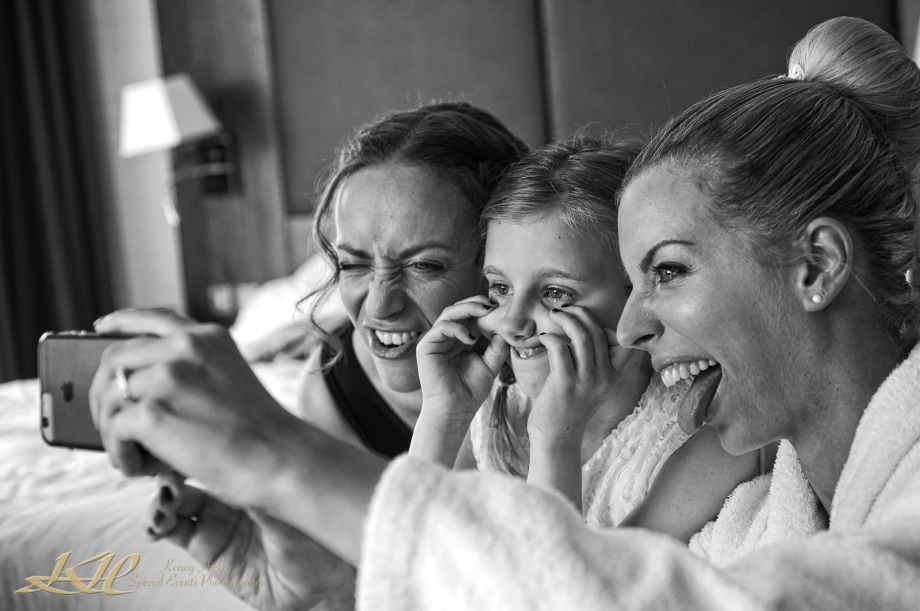 Fun Bride & Bridesmaids pulling faces doing selfies at Hever Castle