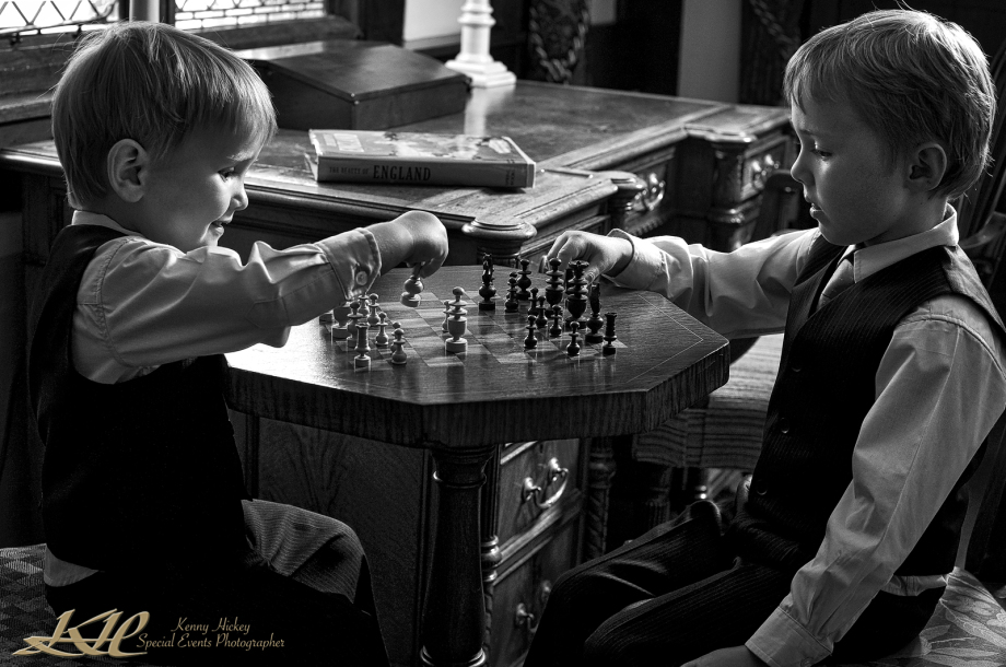 young pageboys playing chess creative black & white