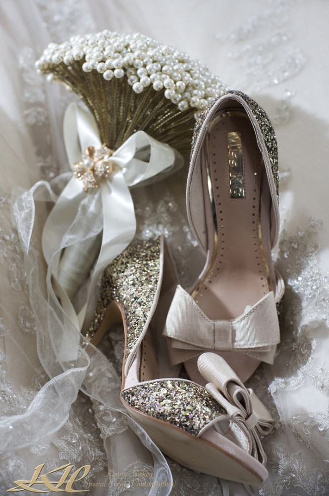 Gorgeous wedding shoes on wedding dress and wedding bouquet