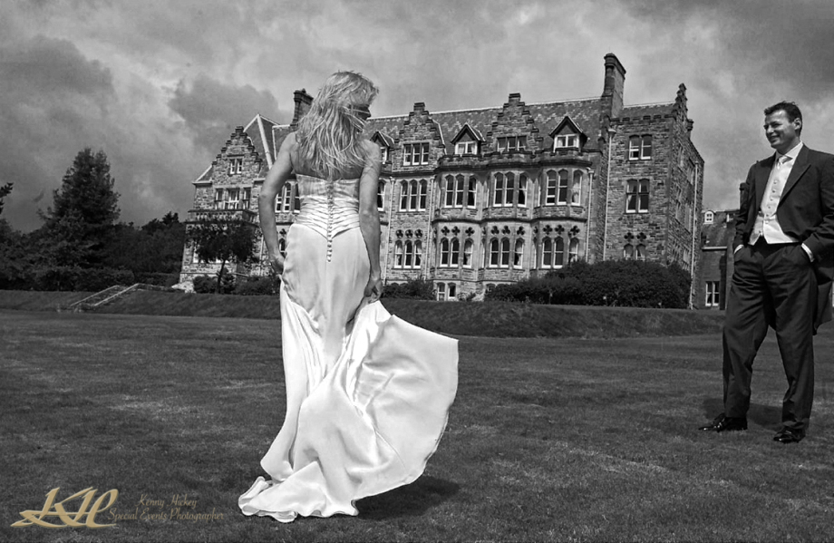 Bride showing groom wedding dress outside Ashdowne Park Hotel