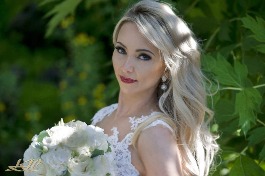 beautiful blond Russian bride with leafy background