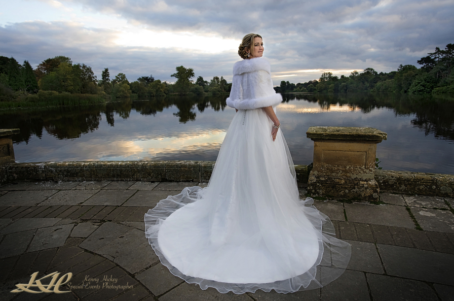 beautiful American Bride by Hever Castle Lake at sunset