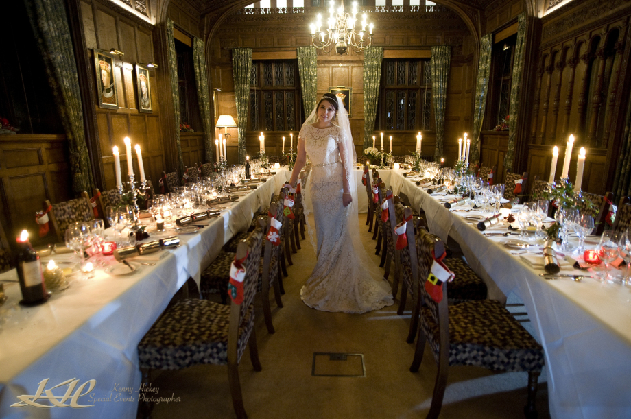 Beautiful wedding bride at Hever Castle posing by Xmas wedding breakfast in candlelight