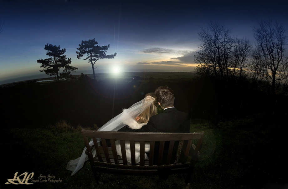bride & Groom on Bench at Sunset, romantic