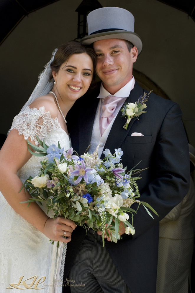 Handsome Bride & Groom with top hat and bridal flowers