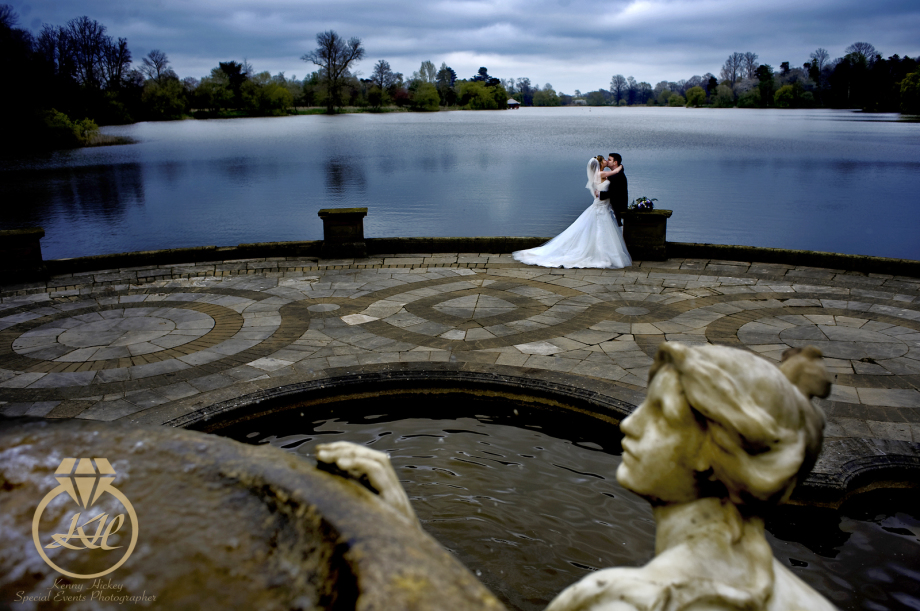 Kathy & Howard wedding at Hever Castle Loggia, romantic kiss by lake