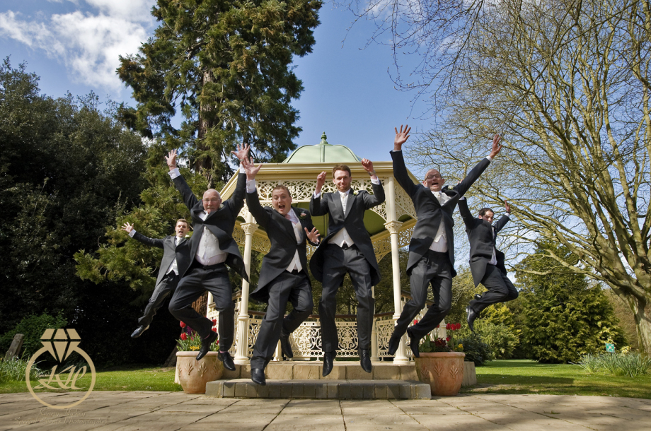 Groom & Groomsmen jumping at Quex Park wedding