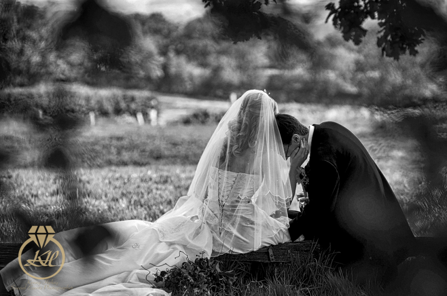Bride & Groom romantic cuddle in field