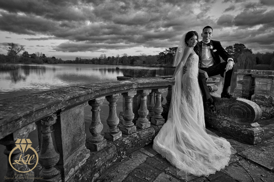 Columbian bride & Groom by Hever Castle lake in black & white