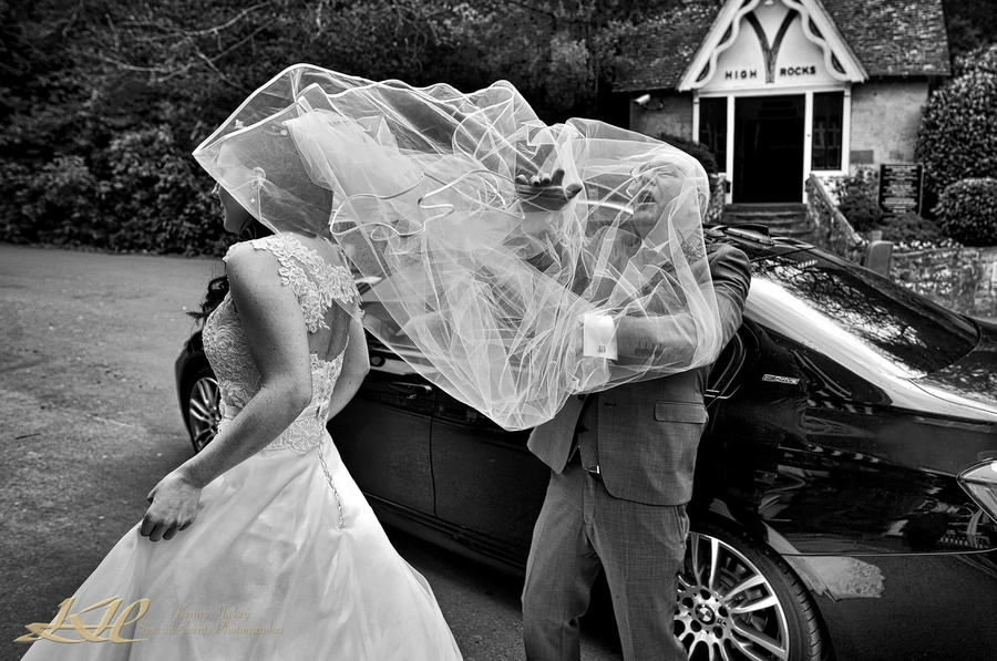 Brides Father caught up in windy veil at High Rocks Tunbridge Wells