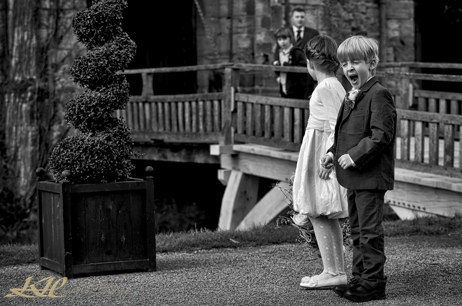 Page boy yawning at Hever Castle