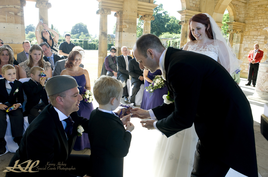 page boy giving rings to groom Hever Wedding