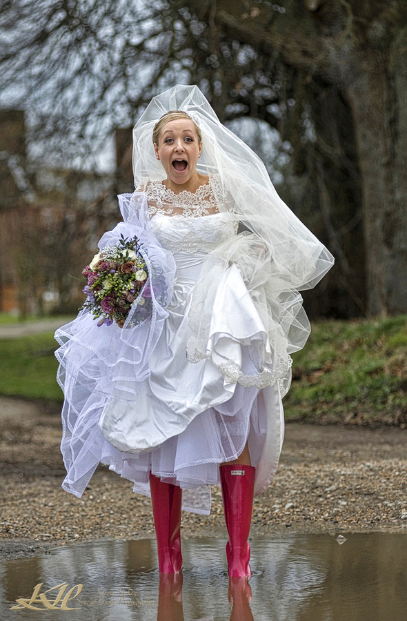 Bride in pool of water in Pink Wellies and bouquet,Kenny Hickey Photography, Kent Wedding Photographer