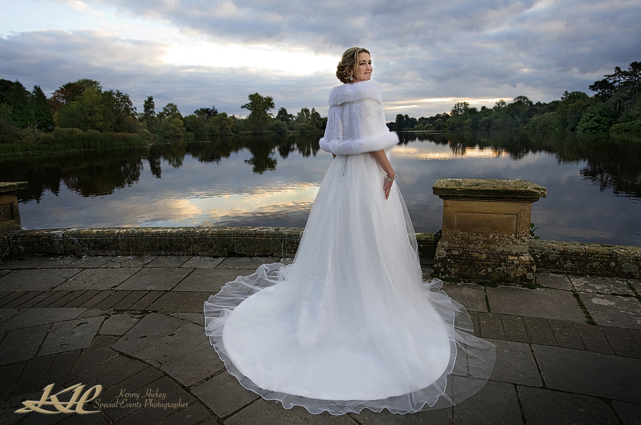 Beautiful American Bride in long wedding dress by Hever Castle Lake at sunrise, sunset, Kenny Hickey Photography, Kent Wedding Photographer