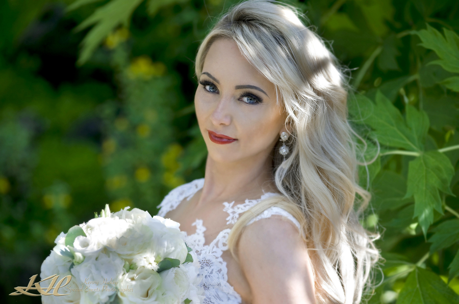 Stunning Russian bride with bouquet at Hever Castle, Kenny Hickey Photography, Kent Wedding Photographer