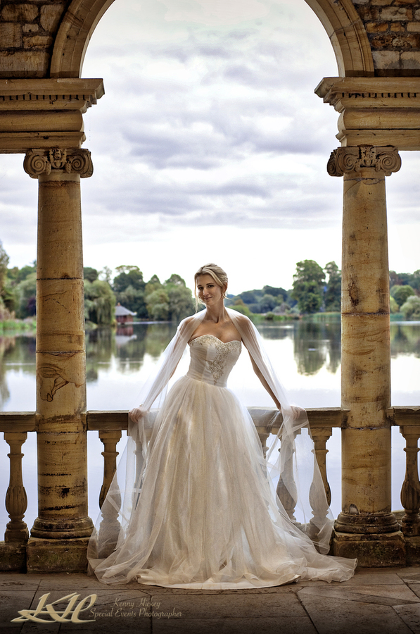Beautiful American Bride Hever Castle lake with flowing veil, Kenny Hickey Photography, Kent Wedding photographer