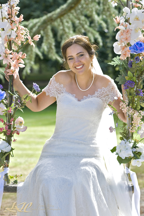 Stunning English Bride on swing with flowers, Kenny Hickey, Kent Wedding Photographer