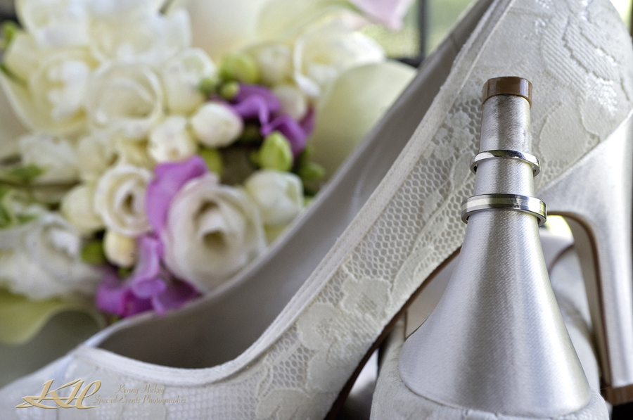 wedding rings on Brides shoes with bridal flowers