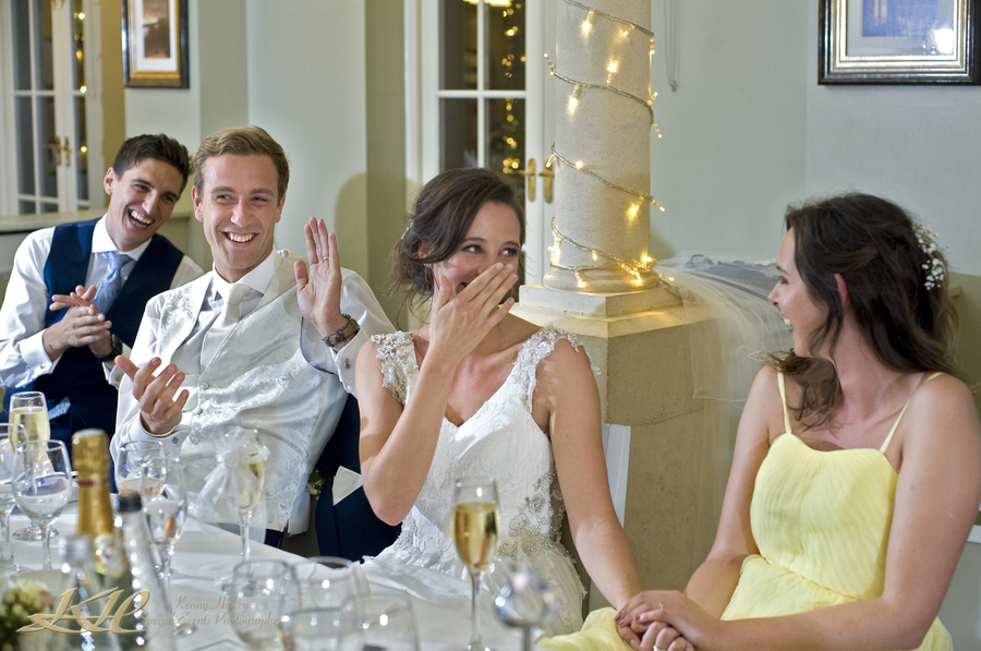 The wedding speeches, laughing bride